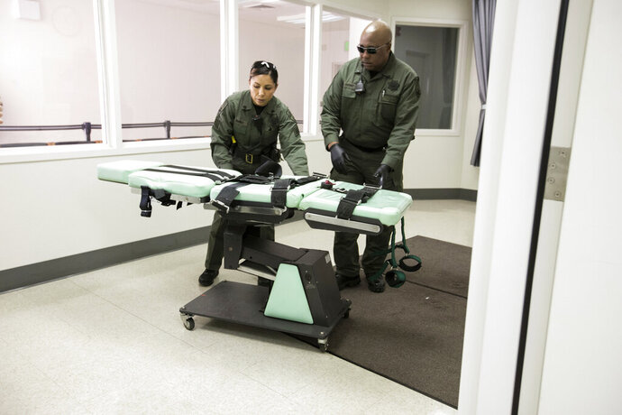File - In this March 13, 2019, file photo, provided by the California Department of Corrections and Rehabilitation, a gurney is removed from the death penalty chamber at San Quentin State Prison in San Quentin, Calif. California's Supreme Court has refused to block death penalty cases from continuing during Gov. Gavin Newsom's moratorium on executions. The justices on Wednesday, Sept. 11, 2019, rejected defense attorneys' arguments that jurors can't realistically gauge the seriousness of imposing a death sentence if they think it's never actually going to be carried out. Newsom halted executions in March for as long as he remains governor. (California Department of Corrections and Rehabilitation via AP, File)