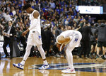 Duke forward Cam Reddish (2) walks off the court as his teammate guard Tre Jones (3) covers his face after losing to Michigan State in the NCAA men's East Regional final college basketball game in Washington, Sunday, March 31, 2019. Michigan State won 68-67. (AP Photo/Alex Brandon)