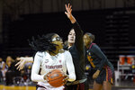 Stanford forward Francesca Belibi, left, is defended by Southern California forward Alissa Pili during the first half of an NCAA college basketball game in Santa Cruz, Calif., Sunday, Jan. 24, 2021. (AP Photo/Jeff Chiu)