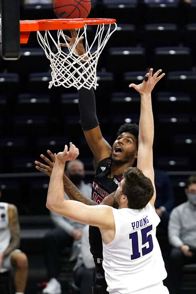 Rutgers center Myles Johnson, left, shoots against Northwestern center Ryan Young, right, during the first half of an NCAA college basketball game in Evanston, Ill., Sunday, Jan. 31, 2021. (AP Photo/Nam Y. Huh)