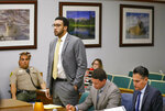 FILE - In this June 14, 2019 file photo, former NFL football player Kellen Winslow Jr, standing second from left, speaks during a court hearing in Vista, Calif. Winslow pleaded guilty Monday, Nov. 4, to raping an unconscious teen and sexual battery involving a 54-year-old hitchhiker. (Howard Lipin/The San Diego Union-Tribune via AP, Pool, File)