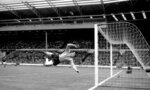 FILE - In this May 5, 1965 file photo Gordon Banks jumps to make a save in a soccer match against Hungary at Wembley stadium in London. English soccer club Stoke said Tuesday Feb. 12, 2019 that World Cup-winning England goalkeeper Gordon Banks has died at 81.  (PA via AP, File)