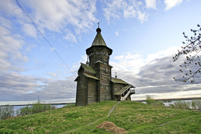 This photo taken on Thursday, May 24, 2012 shows a view of the Dormition Church in Kondopoga, in Karelia region, in northwestern Russia. The 18th century church widely seen as one of the most remarkable examples of Northern Russia's wooden architecture was destroyed by a fire on Friday, Aug. 10, 2018. (AP Photo/Vladimir Larionov)