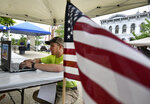 Caleb Antram of Somerset fills out a census form on-line outside of the Somerset Courthouse during the Somerset County commissioners census day party on Tuesday, June 23, 2020.  (Todd Berkey/The Tribune-Democrat via AP)