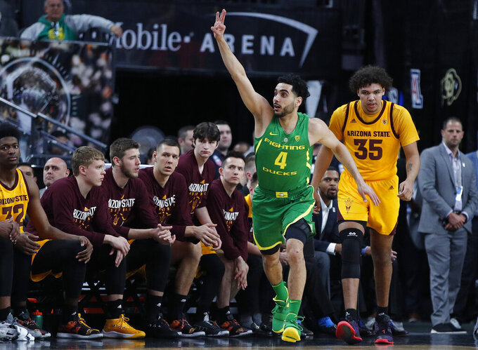Oregon's Ehab Amin celebrates after making a 3-point shot against Arizona State during the first half of an NCAA college basketball game in the semifinals of the Pac-12 men's tournament Friday, March 15, 2019, in Las Vegas. (AP Photo/John Locher)