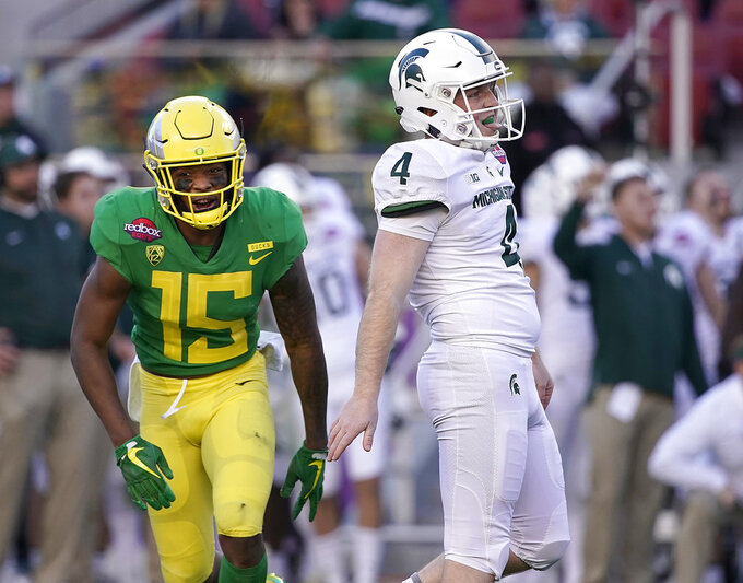 Oregon's Deommodore Lenoir (15) reacts after Michigan State place-kicker Matt Coghlin (4) missed a field goal during the second half of the Redbox Bowl NCAA college football game Monday, Dec. 31, 2018, in Santa Clara, Calif. Oregon won 7-6. (AP Photo/Tony Avelar)