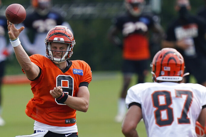 FILE - In this Aug. 26, 2020, file photo, Cincinnati Bengals quarterback Joe Burrow (9) throws a pass during NFL football training camp in Cincinnati. Teams that could struggle mightily after an offseason of constant upheaval are the Giants, Panthers, Browns, Raiders, Jaguars and Lions — all non-playoff clubs a year ago. Do not expect an easy transition for top draft pick Burrow, either. A young quarterback going to a tailender is difficult enough under normal circumstances. (AP Photo/Bryan Woolston, File)
