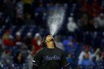 Miami Marlins starting pitcher Jose Urena spits into the air as he walks to the mound during the fourth inning of a baseball game against the Philadelphia Phillies, Friday, April 26, 2019, in Philadelphia. (AP Photo/Matt Slocum)