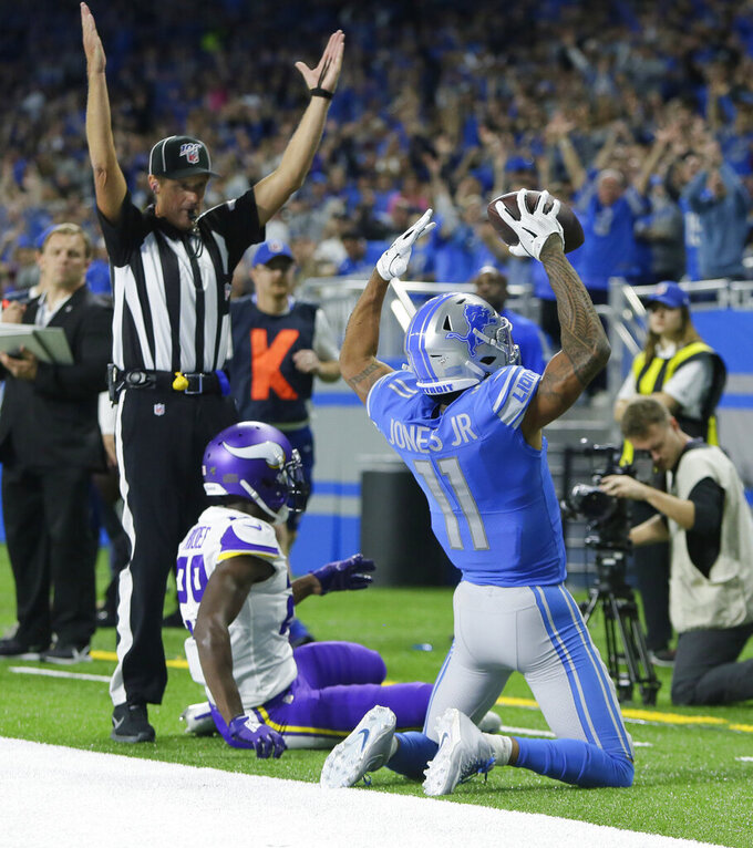 Cousins has 4 TD passes as Vikings surge past Lions 42-30