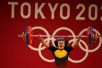 Neisi Patricia Dajomes Barrera of Ecuador competes in the women's 76kg weightlifting event, at the 2020 Summer Olympics, Sunday, Aug. 1, 2021, in Tokyo, Japan. (AP Photo/Luca Bruno)