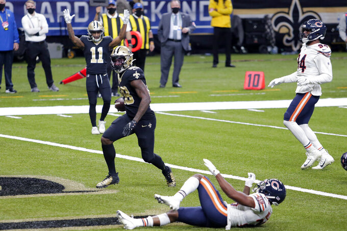 New Orleans Saints running back Latavius Murray crosses the goal line for a touchdown in the second half of an NFL wild-card playoff football game Chicago Bears in New Orleans, Sunday, Jan. 10, 2021. (AP Photo/Brett Duke)