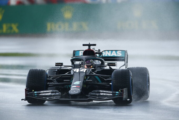 Mercedes driver Lewis Hamilton of Britain steers his car during the qualifying session at the Istanbul Park circuit racetrack in Istanbul, Saturday, Nov. 14, 2020. The Formula One Turkish Grand Prix will take place on Sunday. (AP Photo/Kenan Asyali, Pool)