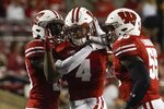 Wisconsin's Donte Burton is congratulated after intercepting a pass during the second half of an NCAA college football game against Eastern Michigan Saturday, Sept. 11, 2021, in Madison, Wis. (AP Photo/Morry Gash)