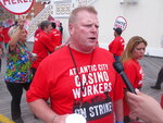 This July 1, 2016 photo shows Bob McDevitt, head of Atlantic City's main casino workers union, during picketing on the Atlantic City, N.J. Boardwalk during a strike. McDevitt, along with the owner of Resorts casino and a retired state senator, say they will appeal the rejection of petition signatures seeking to force a special election to change Atlantic City's form of government. (AP Photo/Wayne Parry)