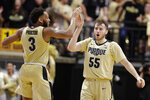 Purdue guards Sasha Stefanovic (55) and Jahaad Proctor (3) celebrate during the second half of the team's NCAA college basketball game against Virginia in West Lafayette, Ind., Wednesday, Dec. 4, 2019. Purdue won 69-40. (AP Photo/Michael Conroy)