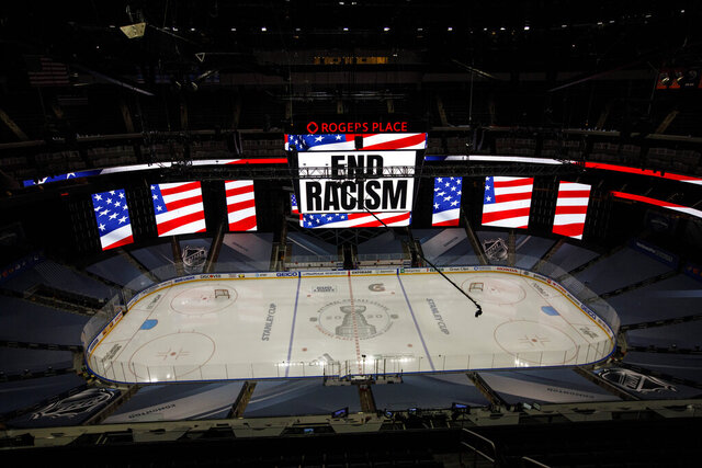 An End Racism sign is displayed before Game 3 of an NHL hockey second-round playoff series between the Colorado Avalanche and the Dallas Stars, Wednesday, Aug. 26, 2020, in Edmonton, Alberta. (Jason Franson/The Canadian Press via AP)