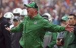 Marshall head coach Doc Holiday reacts on the sideline during an offensive series in the first half  of an NCAA college football game in Blacksburg Va. Saturday, Dec. 1 2018. (Matt Gentry/The Roanoke Times via AP)