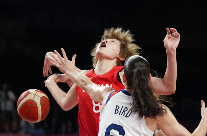 Japan's Maki Takada (8), left, is fouled by United States' Sue Bird (6) during women's basketball preliminary round game at the 2020 Summer Olympics, Friday, July 30, 2021, in Saitama, Japan. (AP Photo/Eric Gay)