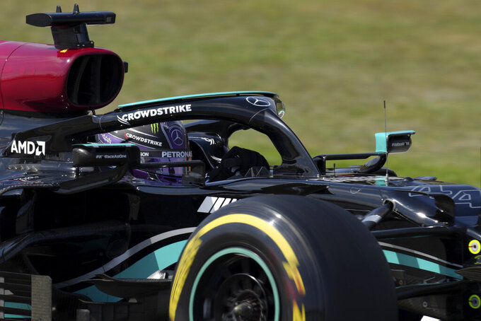 Mercedes driver Lewis Hamilton of Britain takes a curve during the second free practice for the Spanish Formula One Grand Prix at the Barcelona Catalunya racetrack in Montmelo, just outside Barcelona, Spain, Friday, May 7, 2021. The Spanish Grand Prix will be held on Sunday. (AP Photo/Emilio Morenatti)