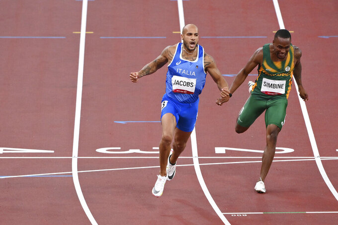 Lamont Marcell Jacobs, of Italy, celebrates after winning the final of the men's 100-meters at the 2020 Summer Olympics, Sunday, Aug. 1, 2021, in Tokyo. (Alfredo Falcone/LaPresse via AP)