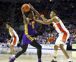 LSU forward Emmitt Williams (5) looks to pass as he tries to keep the ball away Florida defender Kerry Blackshear, Jr., (24) during an NCAA college basketball game, Wednesday, Feb. 26, 2020 in Gainesville, Fla.  (Brad McClenny/The Gainesville Sun via AP)