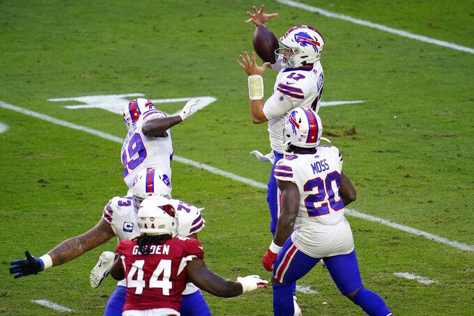 Buffalo Bills quarterback Josh Allen (17) bobbles the football as running back Zack Moss (20) looks on during the first half of an NFL football game against the Arizona Cardinals, Sunday, Nov. 15, 2020, in Glendale, Ariz. (AP Photo/Ross D. Franklin)