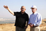 FILE - in this Sunday, June 23, 2019 file photo, US National Security Advisor John Bolton, right, and Israeli Prime Minister Benjamin Netanyahu, visit an old army outpost overlooking the Jordan Valley between the Israeli city of Beit Shean and the Palestinian city of Jericho. Netanyahu vowed Tuesday to begin annexing West Bank settlements if he wins national elections next week. (AP Photo/Abir Sultan, File)