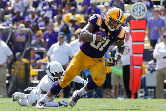 FILE - In this Oct. 5, 2019, file photo, LSU tight end Thaddeus Moss (81) carries on a touchdown reception in the second half of an NCAA college football game against Utah State in Baton Rouge, La. Moss, the son of Hall of Fame receiver Randy Moss, resembles his father in several ways. But he is also distinguishing himself by the way he's grown into his role as a tight end for the No. 1 Tigers. (AP Photo/Bill Feig, File)