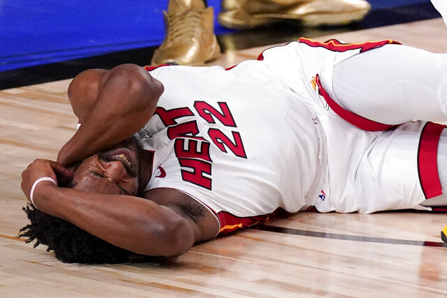 Miami Heat forward Jimmy Butler grimaces after getting fouled during the second half in Game 5 of basketball's NBA Finals against the Los Angeles Lakers Friday, Oct. 9, 2020, in Lake Buena Vista, Fla. (AP Photo/Mark J. Terrill)