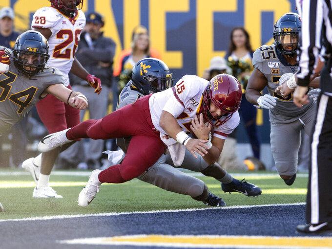 Iowa State quarterback Brock Purdy (15) runs for a touchdown during the first half of an NCAA college football game Saturday against West Virginia, in Morgantown, W.Va. (AP Photo/Raymond Thompson)