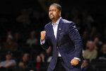 Tulsa coach Frank Haith watches during the first half of the team's NCAA college basketball game against Vanderbilt on Saturday, Nov. 30, 2019, in Nashville, Tenn. (AP Photo/Mark Humphrey)