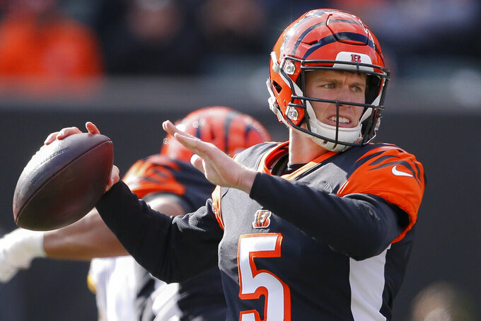 Cincinnati Bengals quarterback Ryan Finley passes during the first half an NFL football game against the Pittsburgh Steelers, Sunday, Nov. 24, 2019, in Cincinnati. (AP Photo/Gary Landers)