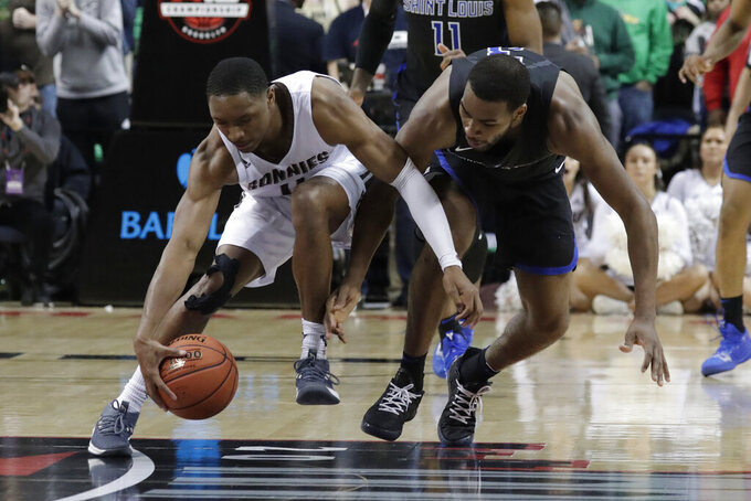 St. Bonaventure guard Kyle Lofton, left, and Saint Louis guard Javon Bess (3) compete for a loose ball during the second half of an NCAA college basketball game in the Atlantic 10 men's tournament final, Sunday, March 17, 2019, in New York. Saint Louis won 55-53. (AP Photo/Julio Cortez)