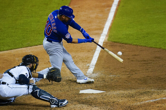 Chicago Cubs' Willson Contreras hits a solo home run in the ninth inning of a baseball game against the Detroit Tigers in Detroit, Tuesday, Aug. 25, 2020. (AP Photo/Paul Sancya)