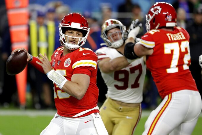 Kansas City Chiefs quarterback Patrick Mahomes (15) passes against the San Francisco 49ers during the first half of the NFL Super Bowl 54 football game Sunday, Feb. 2, 2020, in Miami Gardens, Fla. (AP Photo/Seth Wenig)