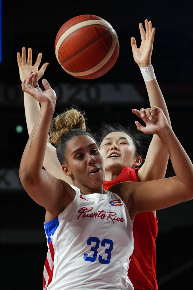 Puerto Rico's India Pagan (33) and China's Zhenqi Pan (10) battle for a rebound during a women's basketball preliminary round game at the 2020 Summer Olympics in Saitama, Japan, Tuesday, July 27, 2021. (AP Photo/Eric Gay)