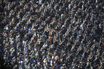 Fans take part in performing the wave during a red flag stoppage in the NASCAR Daytona 500 auto race at Daytona International Speedway, Sunday, Feb. 17, 2019, in Daytona Beach, Fla. (AP Photo/Phelan M. Ebenhack)