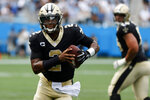 New Orleans Saints quarterback Jameis Winston runs for a touchdown against the Carolina Panthers during the second half of an NFL football game Sunday, Sept. 19, 2021, in Charlotte, N.C. (AP Photo/Nell Redmond)