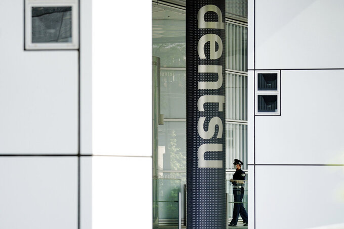The headquarters of Japanese advertising company Dentsu Inc. is seen in Tokyo on June 5, 2020. Domestic sponsors have already contributed a record of $3.3 billion to help pay for the Tokyo Olympics. That's at least twice as much as any previous Games. Now they're being asked to pay millions more to cover some of the soaring costs of the one-year postponement. Dentsu helped land the Olympics, lined up the sponsors, and stands to profit with the Olympics opening on July 23, 2021. (AP Photo/Eugene Hoshiko)