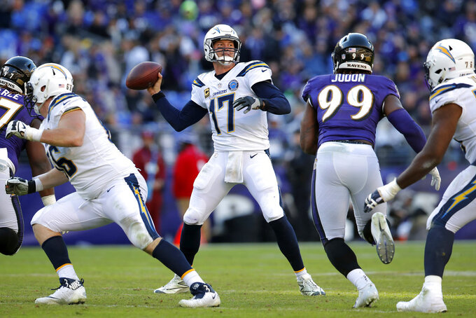 Los Angeles Chargers quarterback Philip Rivers (17) throws a pass in the second half of an NFL wild card playoff football game against the Baltimore Ravens, Sunday, Jan. 6, 2019, in Baltimore. (AP Photo/Carolyn Kaster)