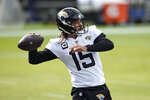 Jacksonville Jaguars quarterback Gardner Minshew II works out prior to an NFL football game against the Baltimore Ravens, Sunday, Dec. 20, 2020, in Baltimore. (AP Photo/Gail Burton)