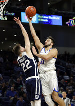 DePaul guard Max Strus, right, shoots over Butler forward Sean McDermott during the second half of an NCAA college basketball game Wednesday, Jan. 16, 2019, in Chicago. Butler won 87-69. (AP Photo/Nam Y. Huh)
