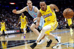 Los Angeles Lakers guard Avery Bradley (11) loses control of the ball as Miami Heat forward Kelly Olynyk (9) defends during the first half of an NBA basketball game, Friday, Dec. 13, 2019, in Miami. (AP Photo/Lynne Sladky)