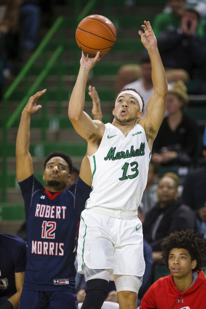 Marshall's Jarrod West (13) shoots next to a Robert Morris defender during an NCAA college basketball game Thursday, Nov. 7, 2019, in Huntington, W.Va. (Sholten Singer/The Herald-Dispatch via AP)