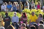 People listen during a memorial service and prayer vigil for the Lesslie family at Fountain Park, Sunday, April 11, 2021, in Rock Hill, S.C. Dr. Robert Lesslie and his wife, Barbara Lesslie, their grandchildren Adah Lesslie and Noah Lesslie, and two men working at the Lesslie home, Robert Shook and James Lewis, were fatally shot last week by former NFL player Phillip Adams. (AP Photo/Sean Rayford)