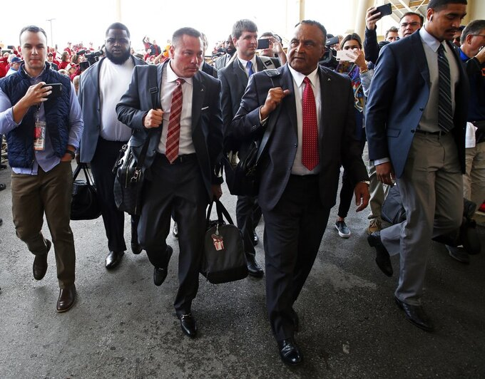 Former Tennessee head football coach Butch Jones, third from left, arrives before an NCAA college football game between Alabama and Tennessee Saturday, Oct. 20, 2018, in Knoxville, Tenn. (AP Photo/Wade Payne)