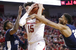 Nebraska's Isaiah Roby (15) wins a rebound against Penn State's Jamari Wheeler, left, and Josh Reaves during the second half of an NCAA college basketball game in Lincoln, Neb., Thursday, Jan. 10, 2019. Nebraska won 70-64. (AP Photo/Nati Harnik)