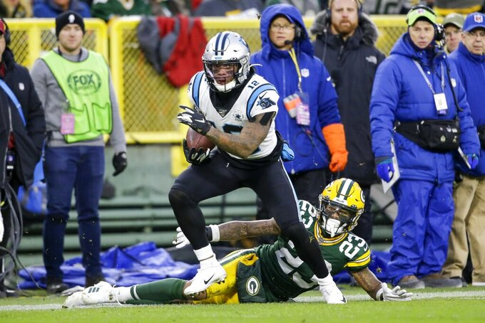 Carolina Panthers' D.J. Moore gets past Green Bay Packers' Jaire Alexander during the first half of an NFL football game Sunday, Nov. 10, 2019, in Green Bay, Wis. (AP Photo/Jeffrey Phelps)