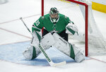 FILE - Dallas Stars goaltender Ben Bishop (30) defends the net during the first period of an NHL hockey game against the St. Louis Blues in Dallas, in this Friday, Nov. 29, 2019, file photo. Stars goaltender Ben Bishop has waived his no-movement clause to be exposed in the Seattle expansion draft next week after approaching his team with the idea. The move, which the team confirmed Thursday, July 15, 2021, allows Dallas to protect veteran goalie Anton Khudobin from the Kraken.  (AP Photo/Brandon Wade, File)
