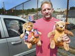 Ben Philips shows off two of his Trump kangaroos outside his apartment in Bloomsburg, Pa., Wednesday, Sept. 19, 2020. Philips is one of the people who died of a medical emergency during the storming of the Capitol on Wednesday, Jan. 6, 2021. He was the founder of a pro-Trump social media site called Trumparoo and had coordinated transportation for several dozen people from Pennsylvania to Washington. (Keith Haupt/Bloomsburg Press Enterprise via AP)